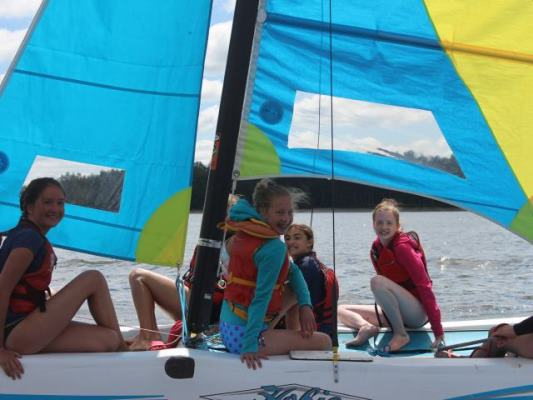 campers on sailboat
