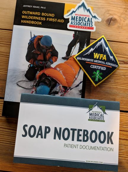 wilderness first aid logo and work books